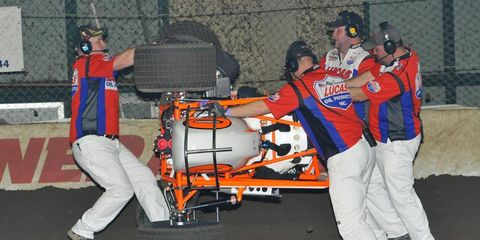 Canada's Glenn Styres shows how sturdy midgets are as he gets pushed back on to four wheels. 2013 Chili Bowl Nationals, Tulsa Expo Raceway, Tulsa, Oklahoma.Photo by Rupert Berrington