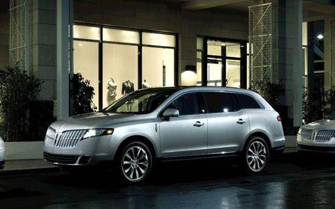 Tire, Wheel, Vehicle, Automotive design, Land vehicle, Automotive lighting, Infrastructure, Car, Alloy wheel, Automotive tire,