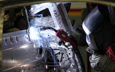 60 percent of the assembly process at Scaglietti is still manual, including this worker employing traditional welding processes.