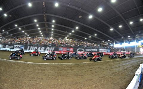Going Bowling // Racers speed around the clay oval inside the QuikTrip Expo Center during the 2012 Chili Bowl Nationals in Tulsa, Okla., on Jan. 14. Photo by: Rupert Berrington