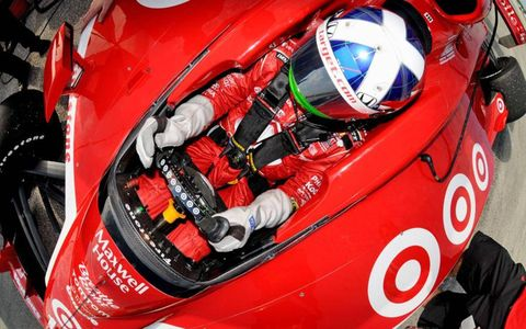 Back in the office: Dario Franchitti and his Target Chip Ganassi Racing crew returned to work during an Izod IndyCar Series pre-season test at Sebring International Raceway in January.