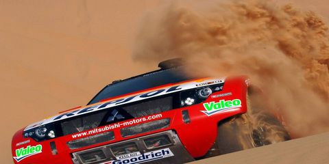 Automotive exterior, Logo, Font, Automotive tail & brake light, Smoke, Dust, Bumper, Automotive exhaust, Brand, Carbon,