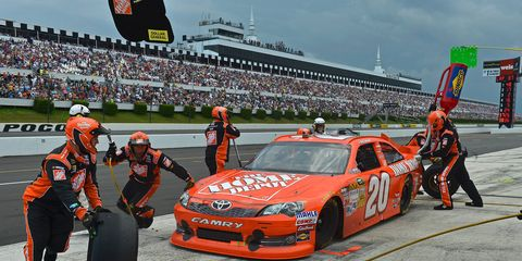 The sky darkens over Pocono Raceway in 2012. A woman is suing NASCAR and Pocono Raceway after a lightning strike near the track killed her husband in 2012.
