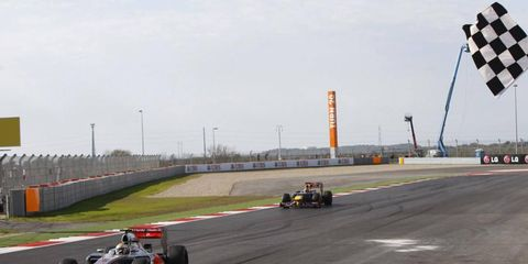 Lewis Hamilton crosses the finish line in the first racing event held at Circuit of the Americas in Austin last November.