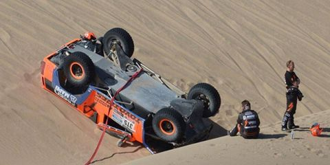 Robby Gordon overtuned his Hummer at the Dakar Rally on Tuesday and lost more than two hours. He is almost six hours behind the leader.