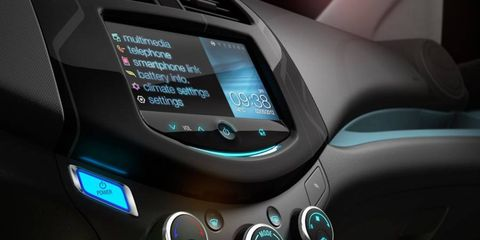 Automotive design, Display device, Luxury vehicle, Teal, Multimedia, Vehicle audio, Personal luxury car, Electronics, Machine, Flat panel display,