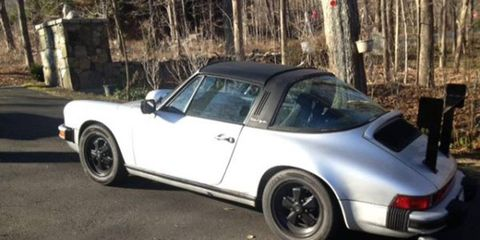 The owner of this 1980 Porsche 911 installed a custom spoiler on its engine cover.