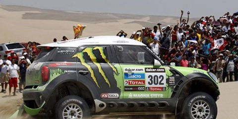 Stephane Peterhansel moved into the lead at Dakar. He leads by nearly three minutes after two days of the rally.