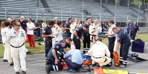 The Formula One medical team works on Fernando Alonso at Spa last season.