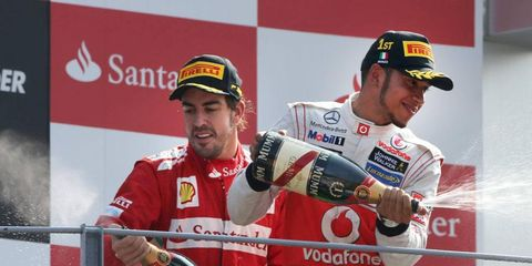 Fernando Alonso, left, says that Lewis Hamilton, right, is a man to watch in Formula One this season.