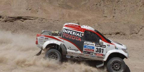 Giniel de Villiers, in a Toyota, finished Wednesday's stage at the Dakar Rally in third place.