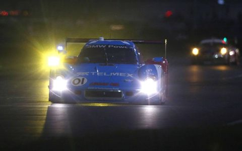 The winners from Chip Ganassi Racing with Felix Sabates roll through the night in the Rolex 24 Hours at Daytona.