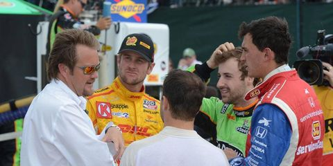 IndyCar Series race director Beaux Barfield, left, talks with drivers during a stoppage in the action at Detroit last season.