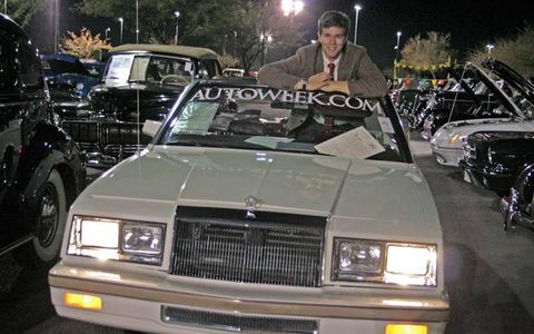 The author and former 1982 Chrysler LeBaron convertible owner poses with the car.
