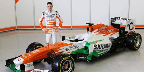 Driver Paul di Resta shows off the new Force India VJM06 at Silverstone on Feb. 1.