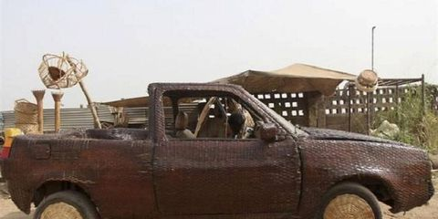 A Nigerian artist covered a Volkswagen Caddy pickup inside and out with raffia palm cane.