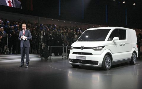 VW's Dr. Eckhard Scholz presents the electric e-CO-motion concept at the 2013 Geneva motor show.