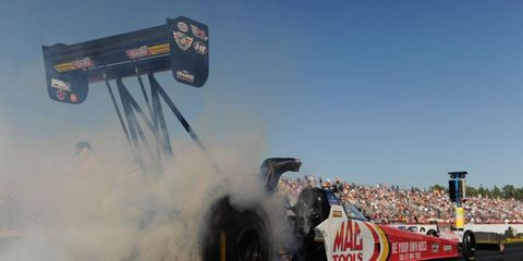 Doug Kalitta notched his second consecutive top-qualifying effort in NHRA Top Fuel with a quick time on Saturday in Gainesville.