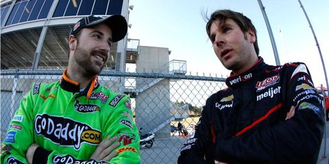 James Hinchliffe, left, and Will Power compare notes during the IndyCar Series open test at Barber Motorsports Park.