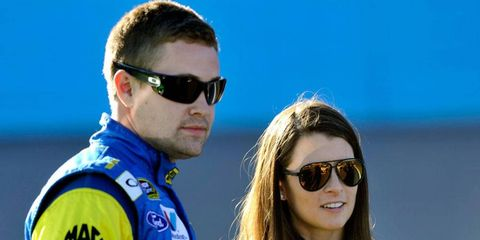 Danica Patrick, shown last week at Phoenix with Ricky Stenhouse Jr., get hit by a rock on Thursday. She'll be fine to race on Sunday in Las Vegas.