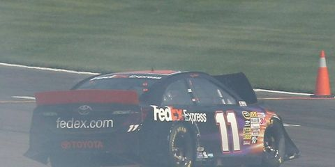 Denny Hamlin's car comes to a halt off the track after his wreck on Sunday at California Speedway.