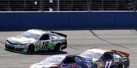 Denny Hamlin (11), fights for position with Joey Logano (22) during Sunday's race at Fontana. The day ended badly for Hamlin after he was involved in a wreck and had to be helicoptered to a nearby hospital.