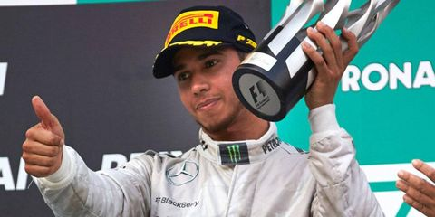 Lewis Hamilton is not so elated at his Formula One podium finish in Malaysia after teammate Nico Rosberg was given orders not to try to pass him late in the race.
