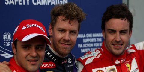 Infiniti Red Bull Racing's Sebastian Vettel, center, will start on the pole for the Malaysian Grand Prix. Ferrari's Felipe Massa, left, will start second, and Fernando Alonso, right, will start third.