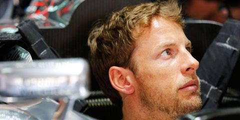 Jenson Button will start the Formula One Malaysian Grand Prix seventh on the grid.