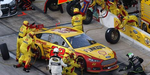 Joey Logano stops in the pits during last week's race at Texas. Logano and teammate Brad Keselowski were both docked 25 points and Penske Racing was fined $200, 000 for the cars having unapproved parts.