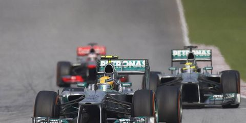 Nico Rosberg drives behind his Mercedes teammate, Lewis Hamilton in the Malaysian Grand Prix. Rosberg says a team orders ordeal is old news.
