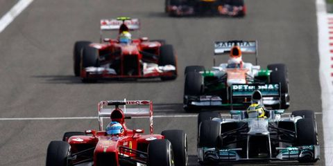 Ferrari driver Fernando Alonso, left, finished eighth place at the Formula One Bahrain Grand Prix.