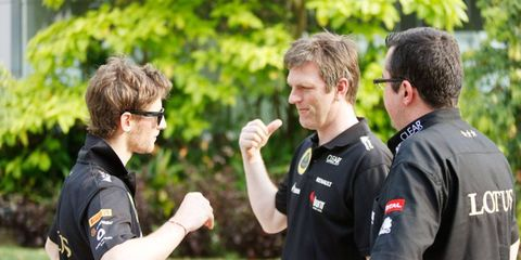 Lotus F1 driver Romain Grosjean, left, talks with James Allison, center, and Lotus team principal Eric Boullier earlier this season in Malaysia.