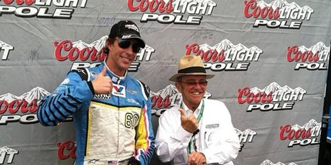 Travis Pastrana, left, and team owner Jack Roush celebrate Patrana's first career pole in the NASCAR Nationwide Series on Friday at Talladega.