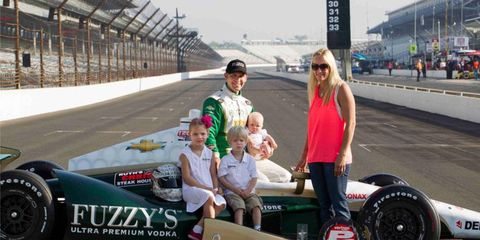 Ed Carpenter celebrates his pole-winning effort with his family at the Indianapolis Motor Speedway in the traditional shot at the start/finish line.