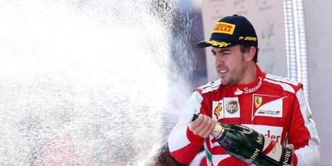 Fernando Alonso celebrates on the podium after his win in Barcelona on Sunday.