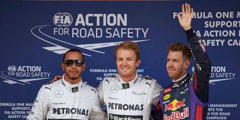 F1 Spanish Grand Prix pole sitter Nico Rosberg, center, is flanked by teammate Lewis Hamilton, left, and Sebastian Vettel.