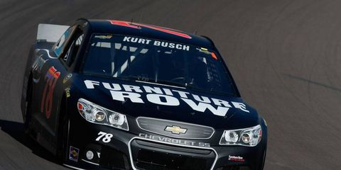 Kyle Busch and brother Kurt Busch, above, swept the NASCAR poles at Darlington on Friday.