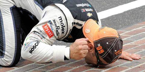 Indianapolis 500 winner Tony Kanaan kisses the row of bricks at the Indianapolis Motor Speedway following his win on Sunday.