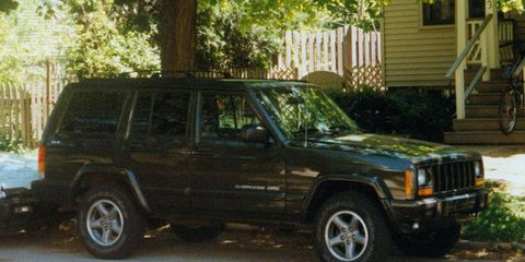 There's my first love -- the '96 Cherokee Classic -- a green beauty standing proud in Maize and Blue Country, Ann Arbor, summer 1999.