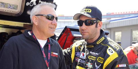 Dale Jarrett, who was recently inducted into the NASCAR Hall of Fame, talks with Elliott Sadler during a recent stop at Dover.