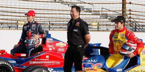 Team owner Michael Andretti (standing) has five drivers in this year's Indy 500, including front-row starters Marco Andretti, left, and Carlos Munoz.