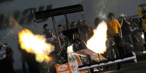 Top Fuel driver Clay Millican raced to the qualifying lead Friday at the Toyota NHRA Summernationals at historic Old Bridge Township Raceway Park.