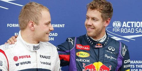 Valtteri Bottas, left, is congratulated by pole sitter Sebastian Vettel after qualifying for the Formula One Canadian Grand Prix on Saturday.