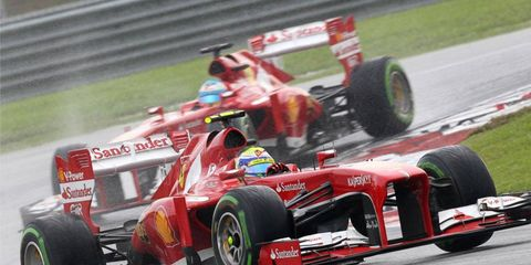 Ferrari's Felipe Massa, front, and Fernando Alonso have their work cut out for them if they are to catch Sebastian Vettel.