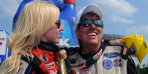 Courtney Force and John Force after the Funny Car final at New England Dragway on Sunday.