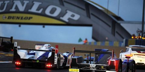 Cars go through their paces on Wednesday at Le Mans ahead of Saturday's 24 Hours of Le Mans endurance race.