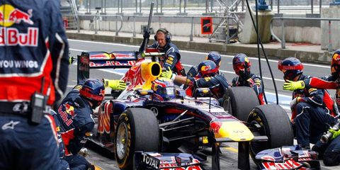 Mark Webber makes a pit stop during the Formula One German Grand Prix on Sunday.