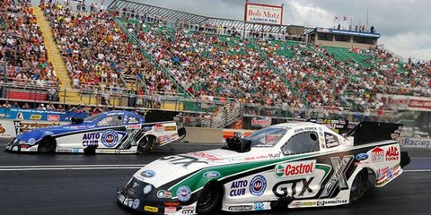 John Force, near lane, won the top qualifying spot for the 143rd time in his NHRA Funny Car career on Saturday in Norwalk, Ohio.