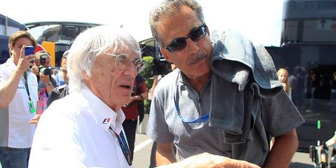 Formula One boss Bernie Ecclestone, left, said that he has no intentions of stepping down amid his indictment this week in Germany.
